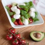 Tomato, avocado and basil salad — Stock Photo