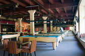 Billiard room with many tables — Стоковое фото
