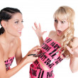 Girl in pink tape dress cuting with scissors — Stock Photo
