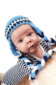 Newborn baby in blue hat — Stock Photo