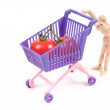 Conceptual photo with miniature shopping-cart - Stock Photo