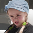 Grimacing little girl — Stock Photo