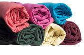 Rotoli di vestiti multicolori — Foto Stock