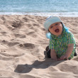 Happy baby boy on the beach — Stock Photo
