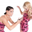 Two girls in pink tape dresses — Stock Photo