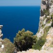 Cliff and blue sea — Stock Photo