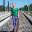 Handsome man on train tracks — Stock Photo