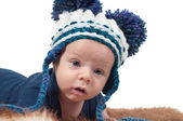 Little baby in cute knitted hat — Stock Photo