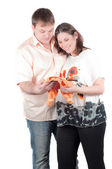Expectant parents with baby clothes — Stock Photo