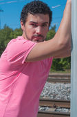Handsome young man in pink t-shirt — Photo
