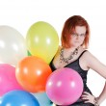 Beautiful woman keeping multicolored air balloons — Stock Photo