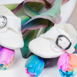 Baby shoes and unusual multi colored tulips — Stock Photo #41847329