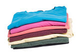 Multicolored clothes in pile — Stock Photo