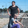 Постер, плакат: Two guys on train tracks