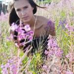 Beautiful brunette woman in field — Stock Photo