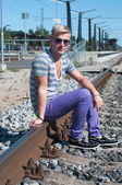 Attractive young guy on rails — Stock Photo