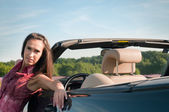 Young woman recline on the car — Stock Photo