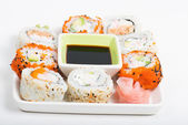Different sorts of sushi on the plate — Stock Photo