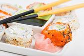 Soy sauce, chopsticks and sushi mix — Stock Photo