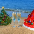 Glasses of champagne, Christmas tree and Santa - Stock Photo