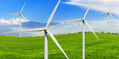 Green meadow with wind power generators — Stock Photo