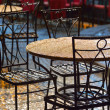 Stock Photo: Tables at an outdoor cafe in the rain
