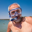 A man with a mask and snorkel for swimming — Stock Photo #12498220