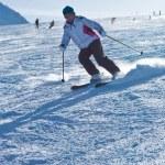 A woman is skiing at a ski resort — Stock Photo #13376514
