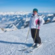 Alpine skier mountains in the background — Stock Photo #13376546