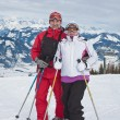 Stock Photo: Alpine skiers mountains in the background