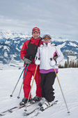 Alpine skiers mountains in the background — Stock Photo