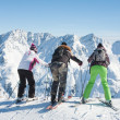 Skiers mountains in the background — Stock Photo #13654877