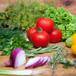 Fresh vegetables on cutting board. - Stock Photo