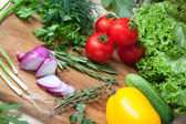Fresh vegetables on cutting board. — Stock Photo