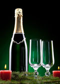 A bottle of champagne with two glasses — Stock Photo