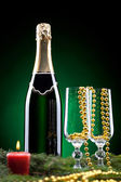 Bottle of champagne with two glasses — Stock Photo