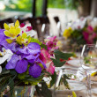 Stock Photo: Bouquet of flowers on table in restaurant.