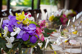Bouquet of flowers on a table in a restaurant. — Stock Photo