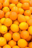 Lots of fresh and ripe oranges. — Stock Photo