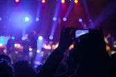 The audience at a concert on the background of the scene. — Stock Photo