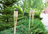 Decoration tiki oil torches. — Stock Photo