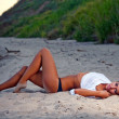 Beautiful young woman relaxing near the sea - Stock Photo