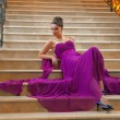Woman in a long dress lying on the stairs — Foto de Stock
