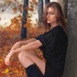Hot young woman in autumn park - Stockfoto
