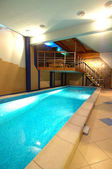 Cosy and beautiful pool in modern hotel — Стоковое фото