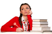 Girl sitting in front of books — Stock Photo