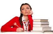 Meisje zit van boeken — Stockfoto
