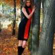 Hot young woman in autumn park — Stock Photo #14779545
