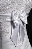 Detail of a weddings dress on a mannequin — Stock Photo