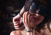 Dominating beauty in handcuffs — Stok fotoğraf